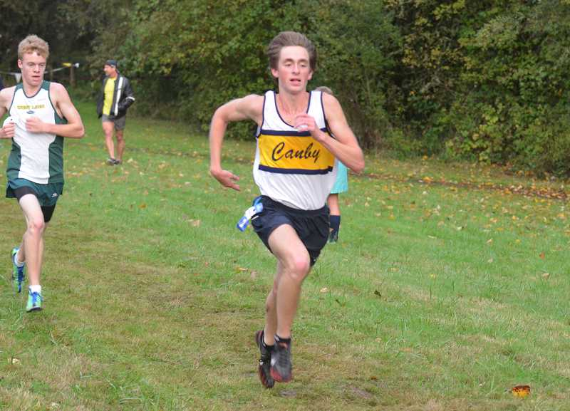 by: JEFF GOODMAN / FILE - Morgan Webber, shown Oct. 2 at Molalla River State Park, led the Canby boys cross-country team Oct. 9 in Gresham. He placed second behind Reynolds senior Ahmed Ibrahim.