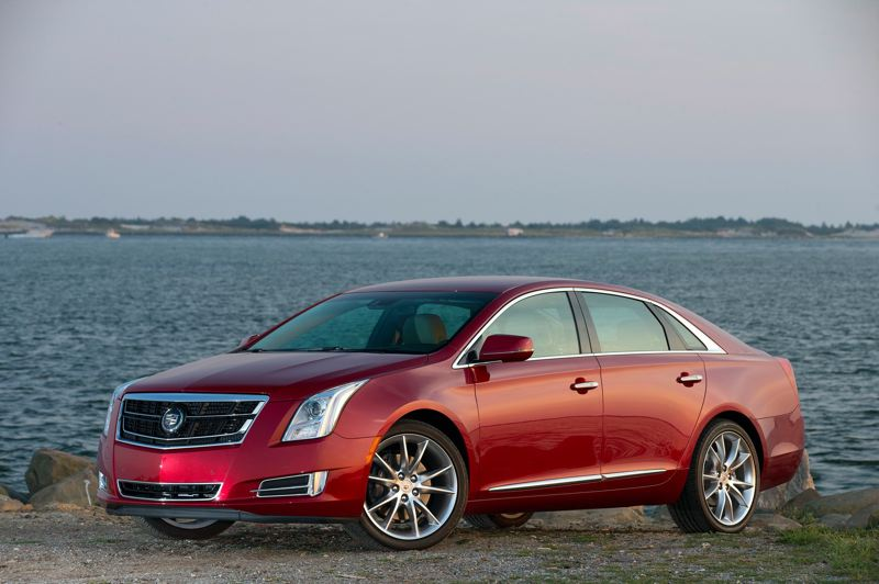 by: GENERAL MOTORS CORPORATION - The 2014 Cadillac XTS Vsport goes as good as it looks.