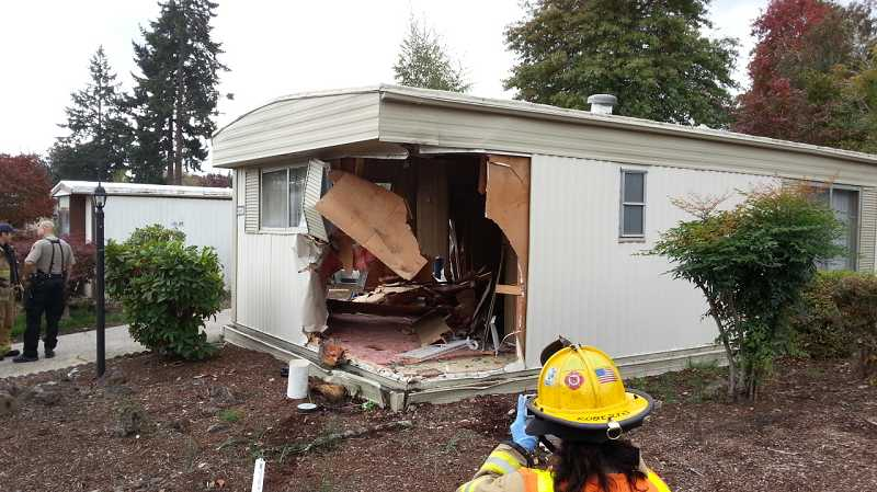 by: WCSO - Fire crews investigate the damage after a car crashes through two homes near King City on Oct. 12.