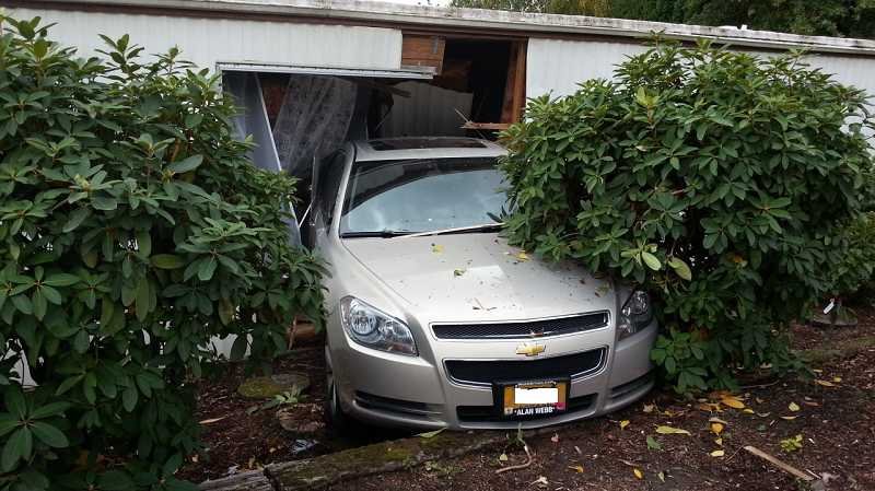 by: WCSO - The car crashed through a living room window of a second home before coming to a halt.