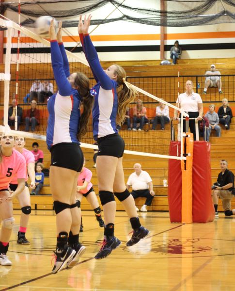 by: CORY MIMMS - La Salles Taylor Shannon and Rachel Berger execute a successful block in last weeks match at Molalla.