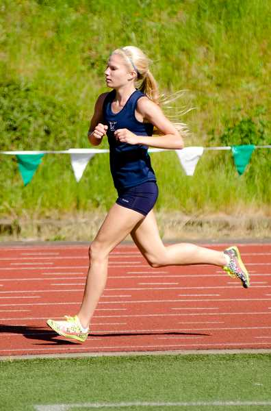 by: GREG ARTMAN / FILE - Taryn Rawlings became the first Wilsonville girl to crack the 18-minute mark in a 5,000-meter cross-country race with her 17:59.7 at Sandelie Golf Course.