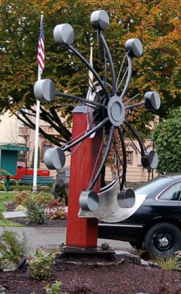 by: PHOTO COURTESY: BEN DYE - Oregon City sculptor Ben Dye's 'E Motion' features a low-boiling point liquid engine that rotates as the sun heats its reused materials. It is pictured in front of Milwaukie City Hall and has been moved to Happy Valley.