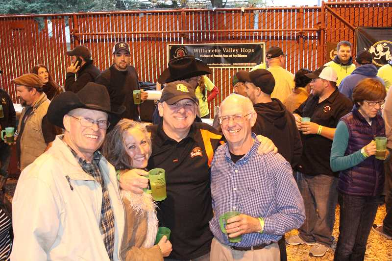 by: JEFF MCDONALD  - Kevin Christensen, Shannon Ernst, Neville Wallace and Butch Kirk celebrate at the St. Paul Fresh Hop Festival Saturday.