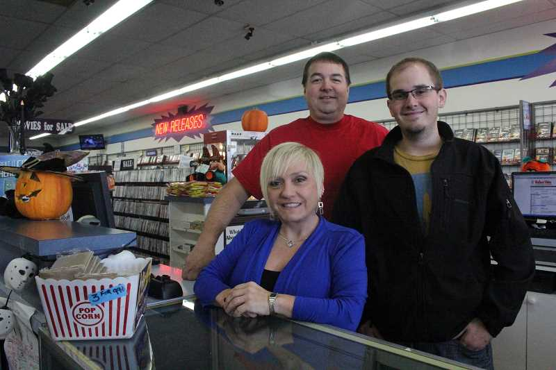 by: LINDSAY KEEFER - Wallace Video has been run by the Wallace family for 25 years. Current owners are Tim and Tina Wallace, pictured here with son Brandon (right), who also works at the store.