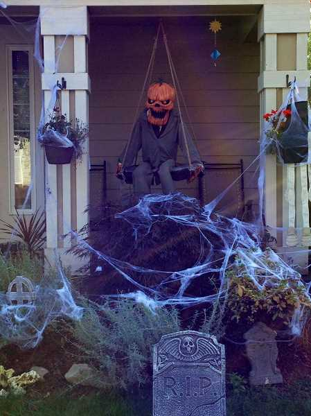 by: LORI HALL - This creepy character hangs out in Editor Lori Halls neighborhood.