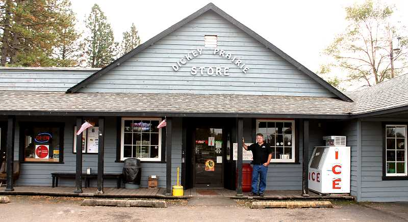 by: CORY MIMMS - Dooley Ham, the new proprietor of Dickey Prairie Store, in front of the shop.