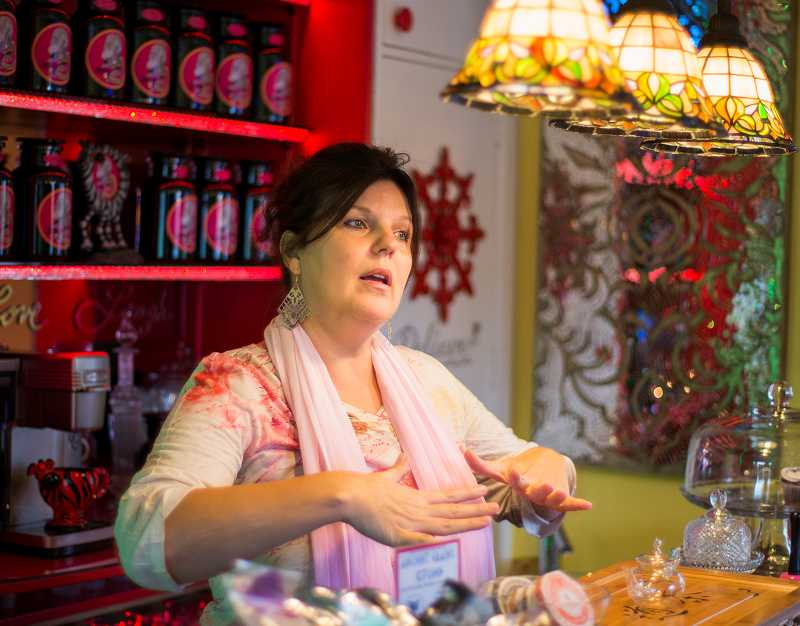 by: NEWS-TIMES PHOTOS: CHASE ALLGOOD - Adelidah (Ah-deh-LEE-dah) Devi is getting ready to offer free specials that will draw more people into her exotically decorated tea shop. Fun is a very big part of health, Devi said. Color, inspiration, aroma, sound, joy--and, of course, food.