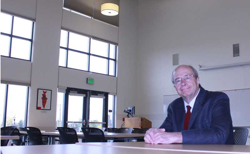 Don Reeder sits in the Madras COCC community room named in his honor.