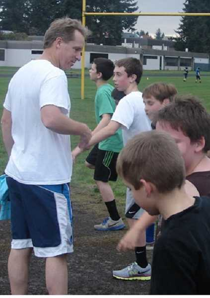 by: SUBMITTED PHOTO - Canby High coach Bob Webber, below, stops by for practice.