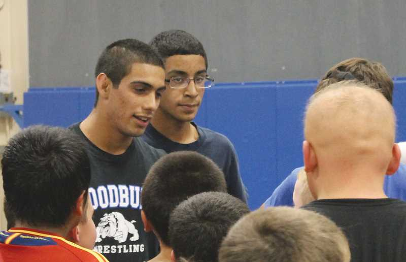 by: PHOTO COURTESY OF DUSTY BAKER - Woodburn wrestler Rodolfo Hernandez hosted a wrestling camp in October for his senior project.