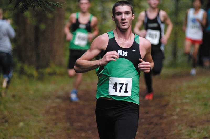 by: DAVID BALL - North Marion senior Christian Parr led all runners Wednesday at McIver Park. The Huskies boys cross country team placed three of the top six runners, as Parr was followed by teammates Colin Barrow in second and Ben Hanberg in sixth.