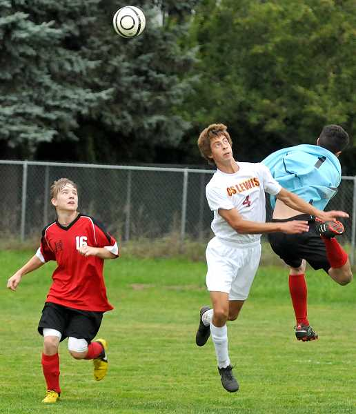 by: SETH GORDON - Collision course - Sam Swan is beaten to the ball by the Horizon Christian (Hood River) goalie during C.S. Lewis Academy's 1-0 victory Oct. 10. Swan scored four of the Watchmen's five goals during their current three-game winning streak.
