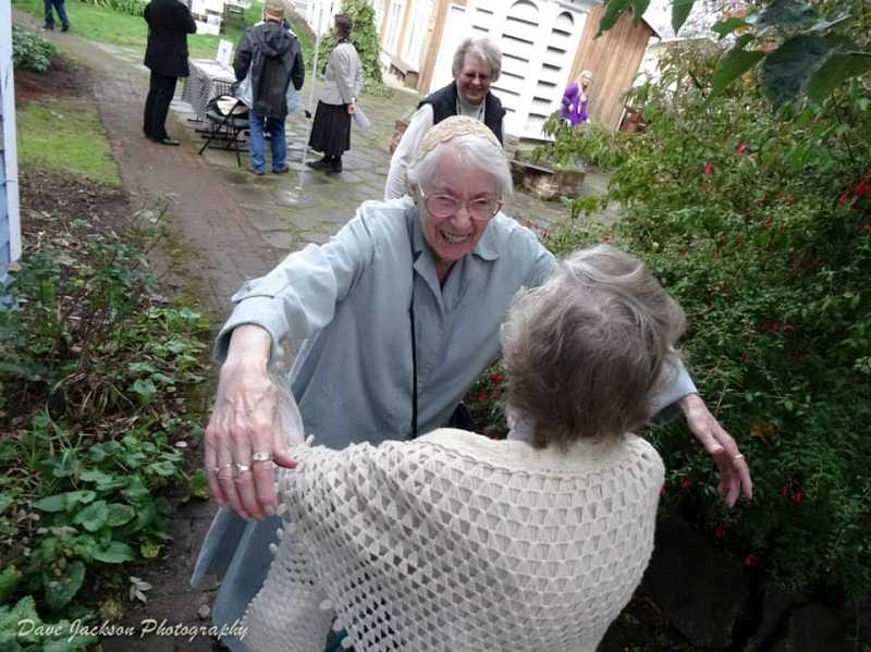 by: DAVE JACKSON - Beryl Cox greets old friend Isabel Williams at the Dibble House museum complex before the opening of Molalla's annual Apple Festival. The two women have participated in the festival 30 years and have become fast friends, even though they only see each other once a year at the event.