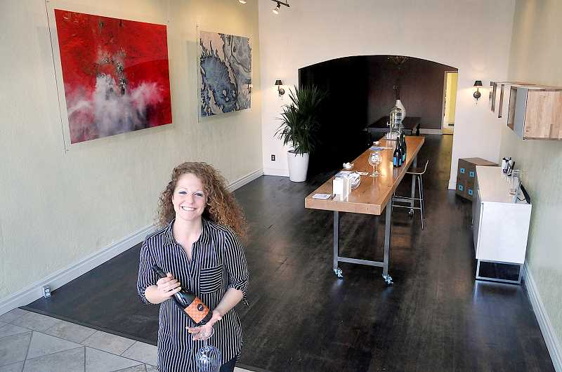 by: GARY ALLEN - Getting started - Jessie Gordon manages Chapter 24 vineyard's new tasting room Fire and Flood. The tasting room, located at 602A E. First St., opened quietly in late September with an open house scheduled for Oct. 28.