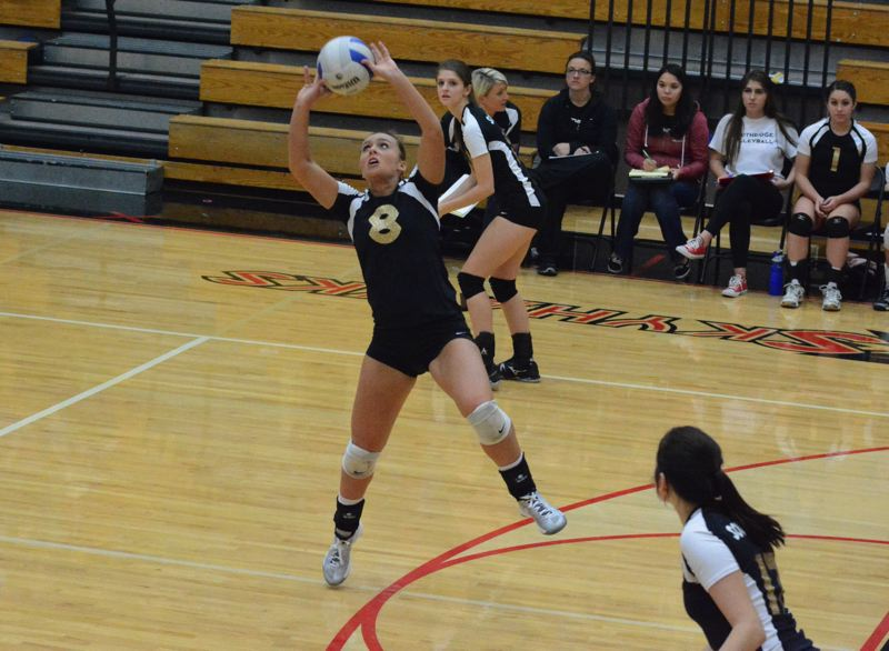by: TIMES PHOTO: MATT SINGLEDECKER - Southridge senior setter Nicole Rigoni gets ahold of a Jesuit spike attempt.