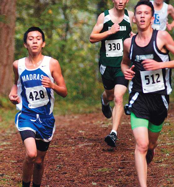by: DAVID BALL/PAMPLIN MEDIA GROUP - Madras freshman Carlos Figueroa, left, was the top boys finisher for the White Buffalos at the Estacada Invitational. He placed 28th overall.