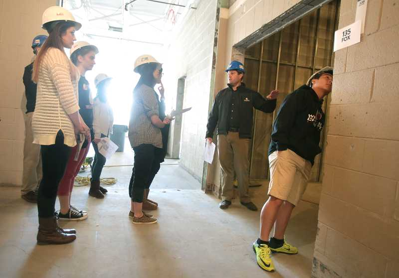 by: TIMES PHOTO: JONATHAN HOUSE - Westside Christian High School principal Steve Pringle shows a group of sophomores their new building in Tigard.