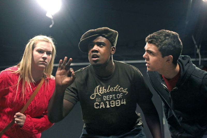 by: TRIBUNE PHOTO: JONATHAN HOUSE - Grant High School student Javon Carter (center) rehearses his role as Louis Armstrong in the upcoming Oregon Childrens Theatre production of Magic Tree House: A Night in New Orleans with fellow stars Ashlee Waldbauer (left) and Thom Hilton. Carter, who doubles as a Grant football player, wants to pursue a music career, preferably songwriting and producing.