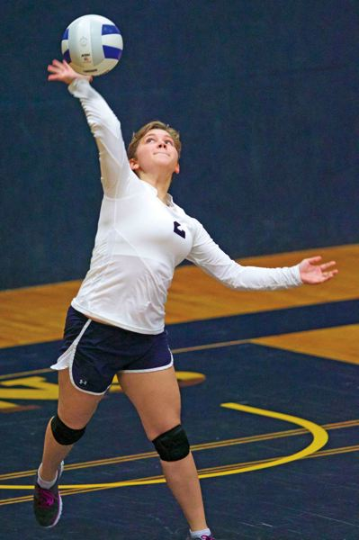 by: TRIBUNE PHOTO: JAIME VALDEZ - City Christian High junior Sam Natale serves in a home match last week against Life Christian. City Christian won 3-0 and improved to 12-3 overall, good for second place behind Portland Lutheran in the Class 1A Valley 10 League.