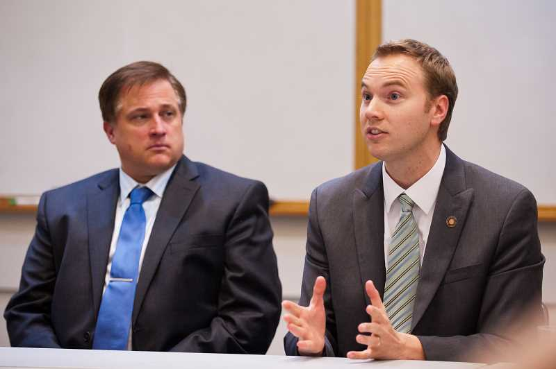 by: JOSH KULLA - Rep. John Davis, R-Wilsonville, speaks at a recent legislative open house in Wilsonville.