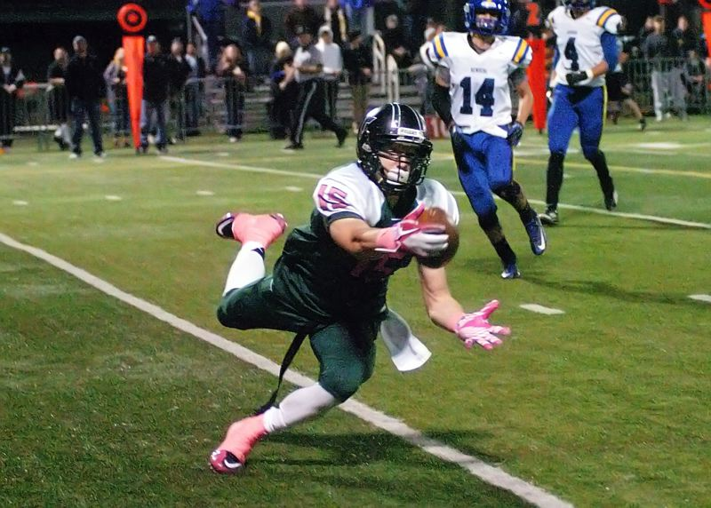 by: DAN BROOD - WHAT A CATCH -- Tigard senior tight end Nick Duron makes a diving, one-handed catch for a touchdown in the Tigers' 63-21 win over Newberg.