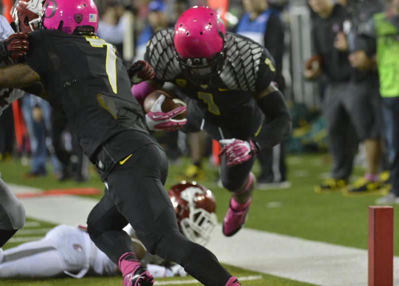 by: COURTESY OF MICHAEL WORKMAN - Oregon Ducks receiver Josh Huff drives into the end zone at the end of a 17-yard touchdown play, as fellow wideout Keanon Lowe blocks during Saturday's home win over Washington State.