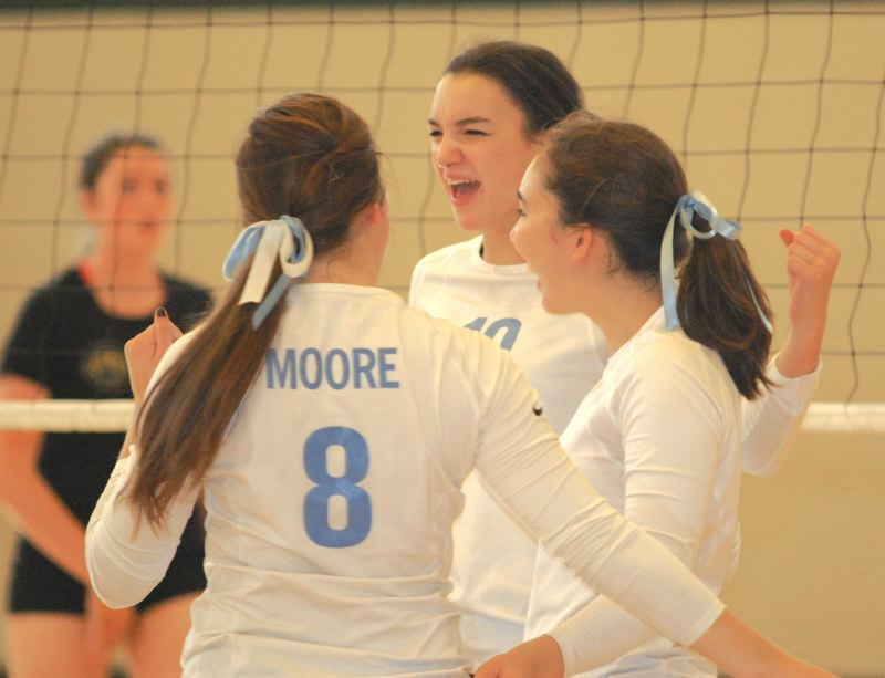 by: PAMPLIN MEDIA GROUP: DAVID BALL - Lakeridge senior Saskia McNairy celebrates with teammates after claiming a point during a straight-set pool-play win over Barlow.