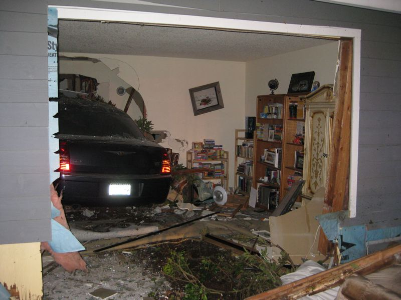 by: CCSO - James Lee of Oregon City crashes into this Milwaukie-area home on Saturday morning just after midnight.