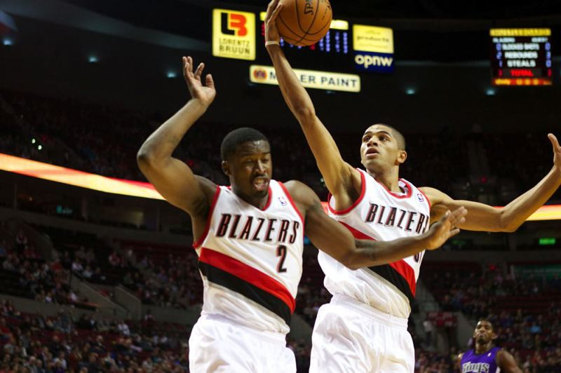 by: TRIBUNE PHOTO: JAIME VALDEZ - Nicolas Batum (right) snares a rebound next to Trail Blazers teammate Wesley Matthews during Sunday night's NBA exhibition victory at home over Sacramento.