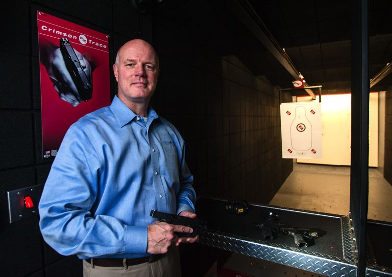 by: SPOKESMAN PHOTO: JOSH KULLA - Crimson Trace President Lane Tobiassen joined the company as marketing director in 2005 and eventually succeeded company founder Lew Danielson at the top in 2009. Here Tobiassen poses in the companys indoor shooting range located at one end of the companys Wilsonville plant.