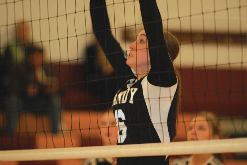 by: SANDY POST: DAVID BALL - Sandys Jenny Covington puts up a block in the middle during the second set Thursday.
