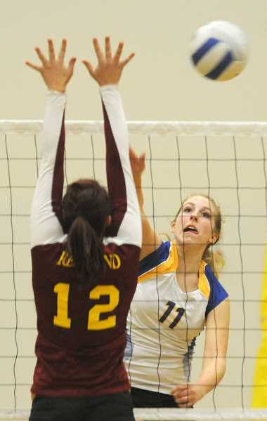 by: LON AUSTIN/CENTRAL OREGONIAN - Jennifer Roth goes up for a kill in the Cowgirls victory over the Redmond Panthers. Roth finished with four kills in the match as the Cowgirls won in straight sets.