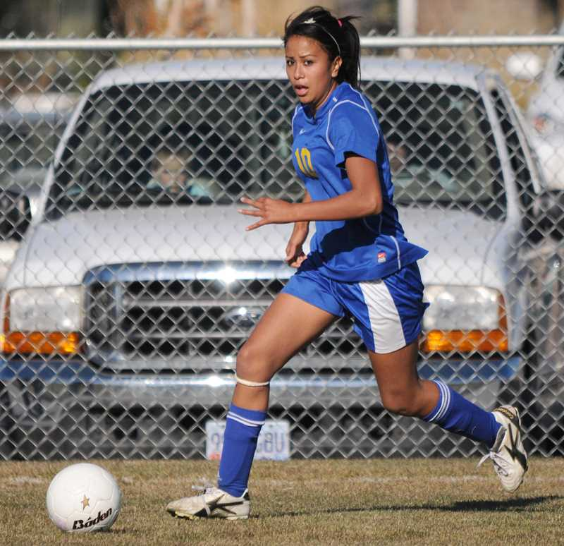by: LON AUSTIN/CENTRAL OREGONIAN - Adriana Villagomez plays the ball during the Cowgirls 4-1 loss to the Ridgeview Ravens on Thursday. Villagomez scored the Cowgirls lone goal in the match.