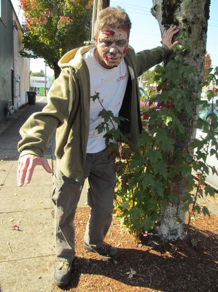 by: PHOTO BY ELLEN SPITALERI - Sean Lavadour, Gladstone Library assistant, wants residents to find their inner zombie and lurch along with him on Oct. 30.