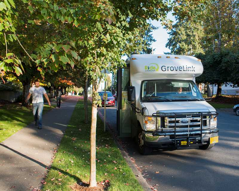 by: NEWS-TIMES PHOTO: CHASE ALLGOOD - The GroveLink buses have nearly tripled their ridership over their first-week total in August. About half the riders arent waiting at bus stops, but rather flag down the 14-passenger vans as they pass.