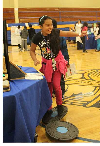 by: LINDSAY KEEFER - Jennifer Cordero, a sixth-grader at French Prairie Middle School, takes part in a balance test at the school's health fair last week.