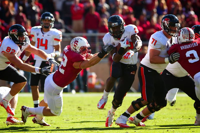 by: COURTESY OF ETHAN ERICKSON/OREGON STATE UNIVERSITY - Oregon State running back Ethan Erickson rushes through a hole against Stanford last season.