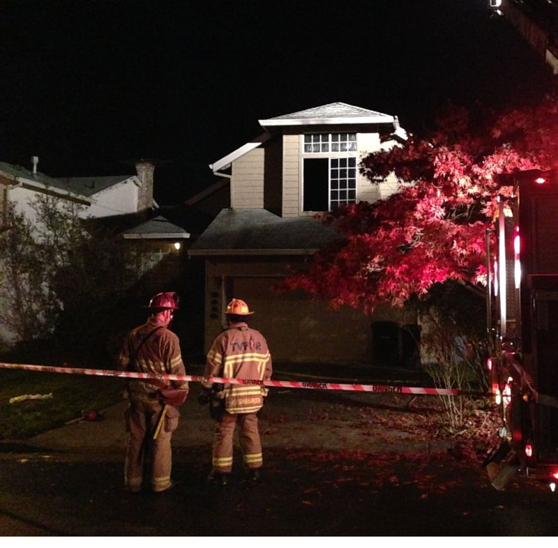 by: COURTESY OF TVFR - Crews from Tualatin Valley Fire & Rescue's Aloha Station 62 battled a fire early Wednesday morning that injured a man and a woman living in the Southwest 214th Place home.