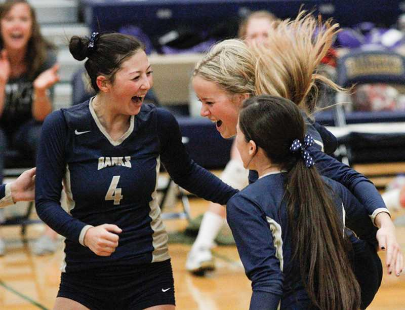 by: NEWS-TIMES PHOTO: AMANDA MILES - Banks junior Alyssa Chung (4) celebrates with teammates Taylor Herb and MaKenna Partain during last Tuesday's three-set sweep of Astoria in Cowapa League volleyball action.