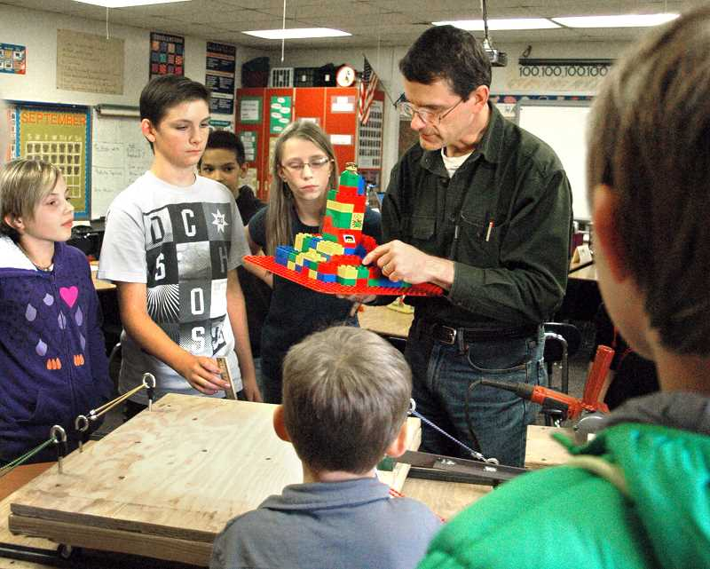 by: ISABEL GAUTSCHI - Structural Engineer David Bugni gives Eagle Creek Elementary students some pointers on structural soundness. Bugni had demonstrated the affects of earthquakes on buildings as part of the school's after school Science Technology Engineering Arts and Mathematics (STEAM) program.