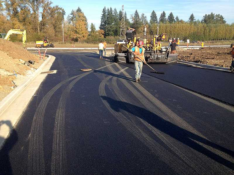 by: CONTRIBUTED PHOTO: MICHAEL PARK - Workers pave the new road on Estacada's Industrial Campus.