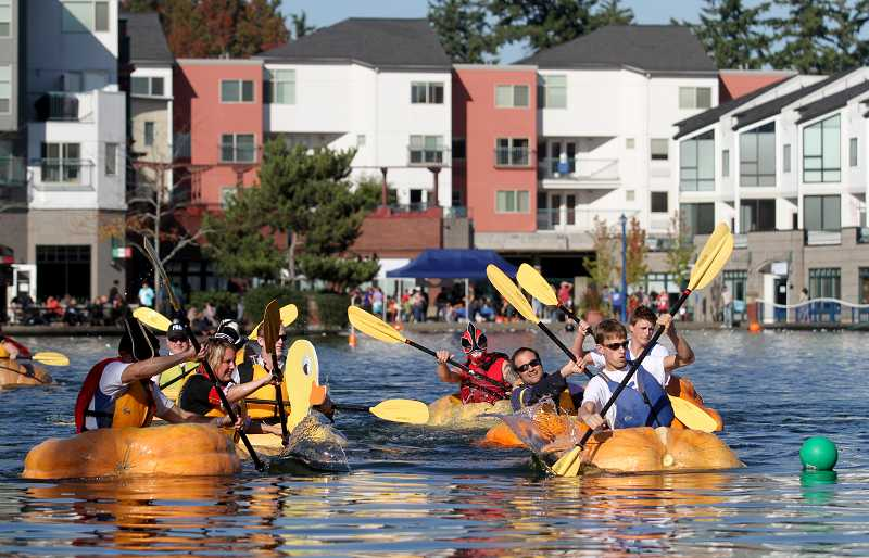 by: TIMES PHOTO: JONATHAN HOUSE - Competitors in the sponsor division of the the West Coast Giant Pumpkin Regatta compete Saturday in Tualatin.