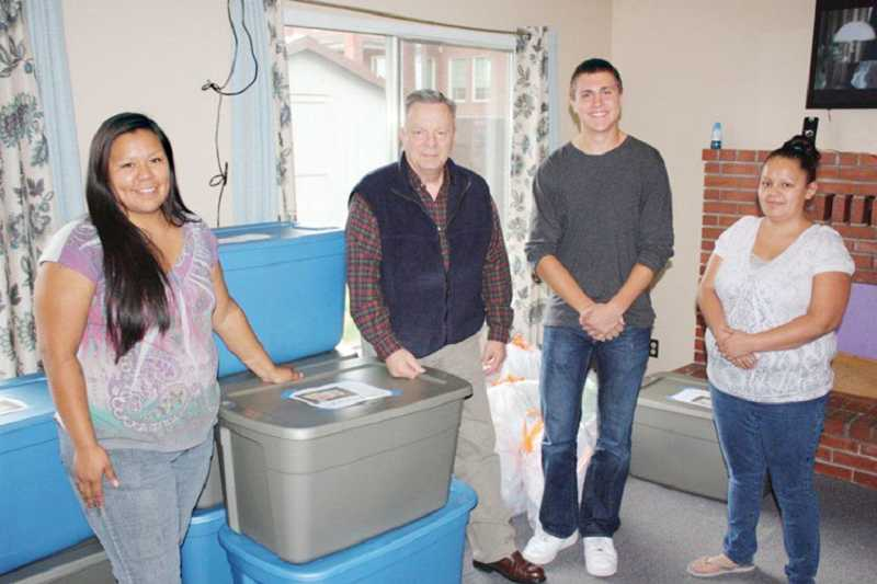 by: SUBMITTED PHOTO - Truman Gabriel, 15, second from right, made care packages for Children's Protective Services in Warm Springs as his Eagle Scout project. Isabel White, protective care provider, at left, CPS Director Ron Hager, and Reggie Clements, right, shelter supervisor, were on hand for the delivery.
