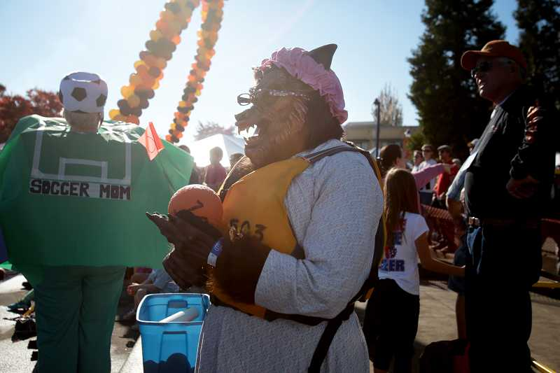 by: TIMES PHOTO: JONATHAN HOUSE - Ignacio Franklin, playing the Big Bad Wolf, waits for his turn at a pumpkin race during the West Coast Giant Pumpkin Regatta.