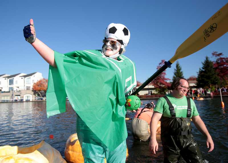 by: TIMES PHOTO: JONATHAN HOUSE - Jolene Hustead gives the thumbs up after a race as 'Soccer Mom' during the West Coast Giant Pumpkin Regatta on Saturday.