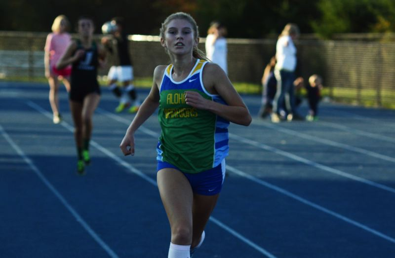 by: TIMES PHOTO: MATT SINGLEDECKER - Aloha senior Allison Martinez won the Warriors home meet last Wednesday and has the second best time in the Metro League.
