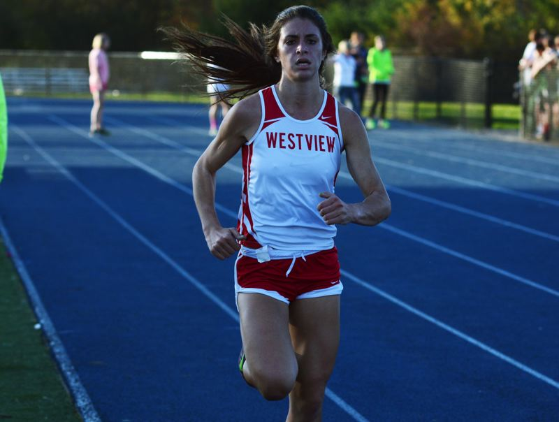 by: TIMES PHOTO: MATT SINGLEDECKER - Westview senior Sarah Medved was the Wildcats top finisher at Aloha last Wednesday and took fourth overall.