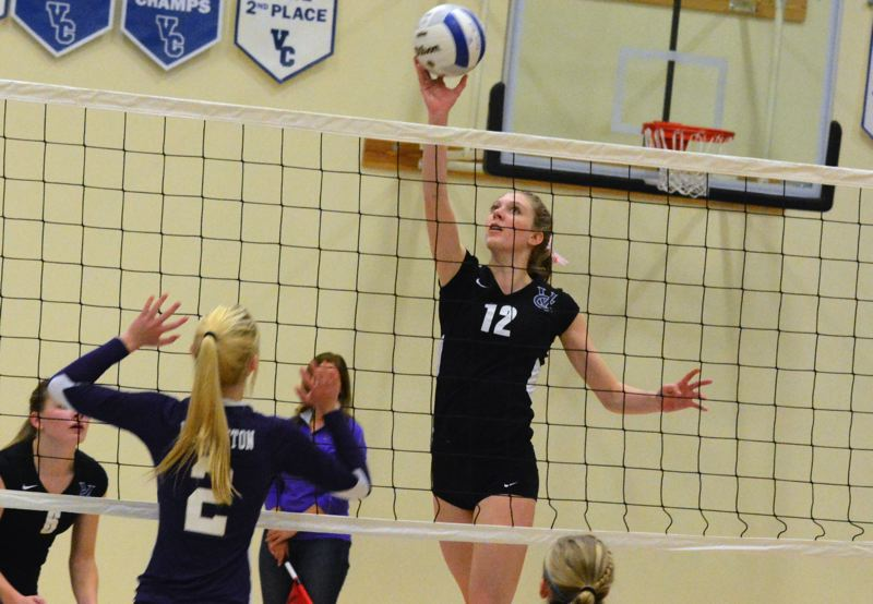 by: TIMES PHOTO: MATT SINGLEDECKER - Valley Catholic senior Katharine Jesse directs a spike to the left side of the floor for the Valiants.