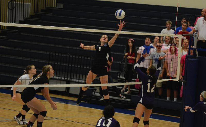 by: TIMES PHOTO: MATT SINGLEDECKER - Valley Catholic senior Ashley Ferris tips a kill attempt with her left hand in the first set of the Valiants three set win over Warrenton.